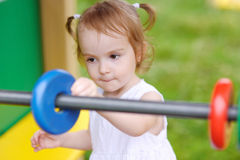 Little girl with toy abacus Royalty Free Stock Photo