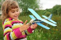 Little girl with toy airplane in hands Royalty Free Stock Image