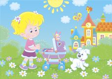 Little girl with a toy baby buggy royalty free stock photography