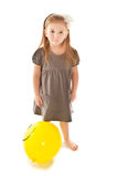 Little girl with toy balloon looking Royalty Free Stock Photos