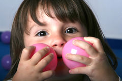 Little Girl and Toy Balls Royalty Free Stock Photography