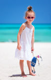 Little girl with toy at beach Stock Photo