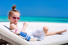 Little girl with toy at beach royalty free stock photography