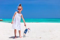 Little girl with toy at beach Stock Images