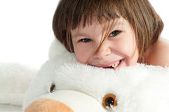 Little girl with toy bear Stock Photography