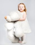 Little girl with toy bear Royalty Free Stock Photography