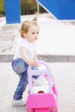 Little girl with toy car Stock Images