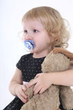 Little girl with toy crying. Over white background Royalty Free Stock Photography