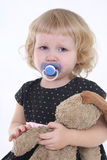Little girl with toy crying. Over white background Stock Photos