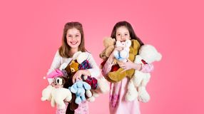 Little girl with toy. Girls holds heap of teddy bears. Girl hugging teddybears, childhood. Two beautiful happy girls stock photos
