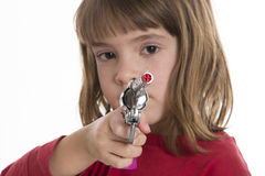 Little girl with a toy gun Stock Photography