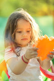 Little girl with toy in hands. Royalty Free Stock Photography