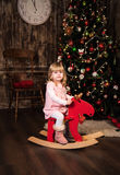 Little girl on a toy horse Royalty Free Stock Images
