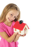 Little girl with toy house Royalty Free Stock Photo