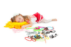 Little girl with toy and jewel isolated on white Stock Photography