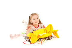 Little girl with toy and jewel isolated on white Royalty Free Stock Images