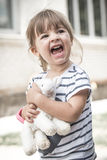 Little girl with toy lamb Royalty Free Stock Photos