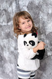 Little girl with toy panda indoors Stock Photo