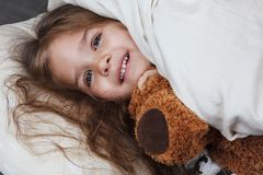 Little girl with toy Stock Image