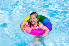 Little girl with toy ring in swimming pool Royalty Free Stock Photography