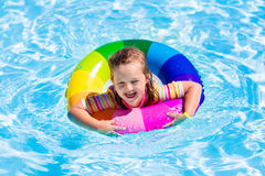 Little girl with toy ring in swimming pool Royalty Free Stock Image