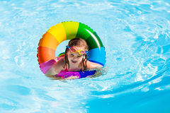 Little girl with toy ring in swimming pool Royalty Free Stock Photo
