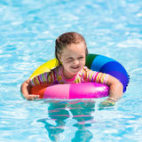 Little girl with toy ring in swimming pool Stock Images