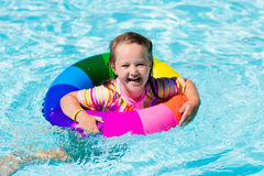 Little girl with toy ring in swimming pool Stock Image