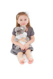 Little girl with toy sitting on the floor Royalty Free Stock Photo