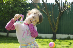 Little girl with a toy smiling. Little girl having a toy smiling on grass Stock Photos