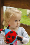 Little girl with a toy Stock Photo