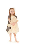 Little girl with toy standing Royalty Free Stock Image