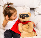 Little girl with toy super hero Royalty Free Stock Photos