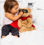 Little girl with toy super hero Stock Photography