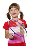 Little girl with a toy tennis racket Royalty Free Stock Photography