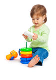 Little girl with toys Stock Image