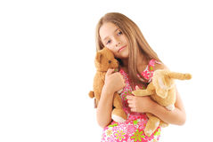 Little girl with toys. On white background Royalty Free Stock Photo