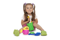 Little girl with toys Stock Photos