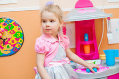 Little girl  with toys in the playroom Royalty Free Stock Photography