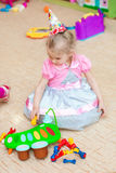 Little girl  with toys in the playroom Royalty Free Stock Images