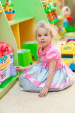 Little girl  with toys in the playroom Royalty Free Stock Photo