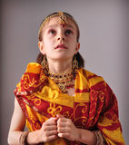 Little girl in traditional Indian sari and jeweler Royalty Free Stock Photos