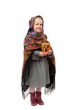 A little girl in traditional Russian kerchief with a pretzel Stock Images