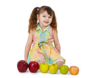 Little girl and train of apples Stock Photo