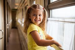 Little girl in the train, railway carriage royalty free stock image