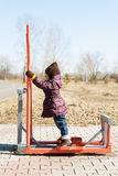 Little girl on a trainer outdoor Stock Photo