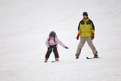 Little girl training alpine skiing Stock Photos