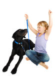 Little girl training  her dog Royalty Free Stock Photo