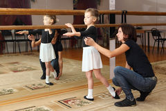 Little girl trains with her ballet teacher royalty free stock photo