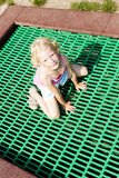 Little girl trampoline Royalty Free Stock Photo